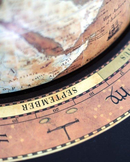 Da Vinci floor globe drinks cabinet - rust, zodiac ring, product photo